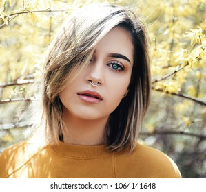 Young woman with septum outdoor portrait