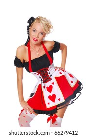 Young woman in a sexy christmas costume is posing