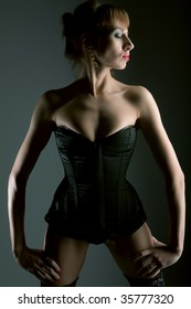 young woman in sexy corset