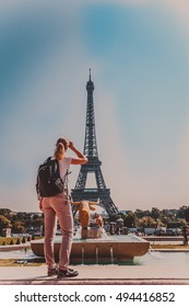 young woman shares the enthusiasm of the visits Eiffel tower in Paris