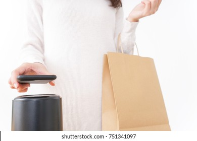 Young woman shipping with electronic money