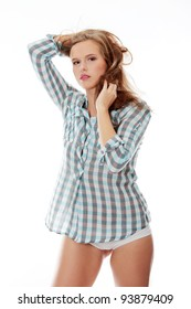 Young woman in shirt posing with wind,isolated on white
