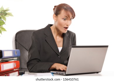 Young woman is shocked by what she sees on the monitor