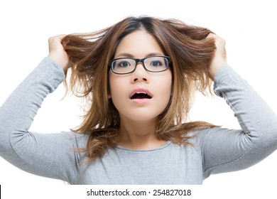 young woman shocked with hand pulling her hair out