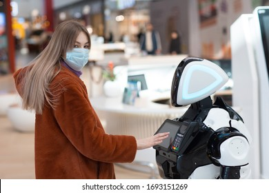 Young woman shopper and robot adviser in the store