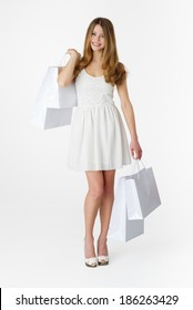 Young woman with shopping bag on white background