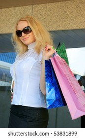 Young woman with shopping bags with glasses