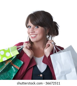 Young woman with shopping bags; isolated on a white background.