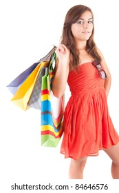 Young woman with shopping bags, isolated over white