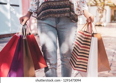 Young woman with shopping bags at shopping mall on black friday, Woman lifestyle concept