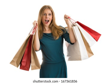 Young woman with shopping bags over white background screaming and wondering