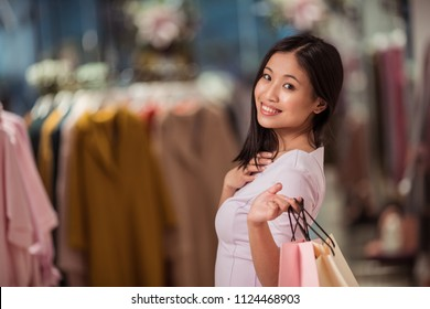 Young woman with shopping bags in a store