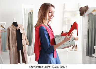 Young woman shopping in boutique. Stylish wardrobe