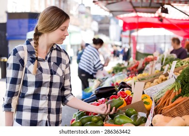 young woman shopping for food at the market