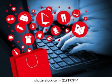 Young woman shopping online by using laptop