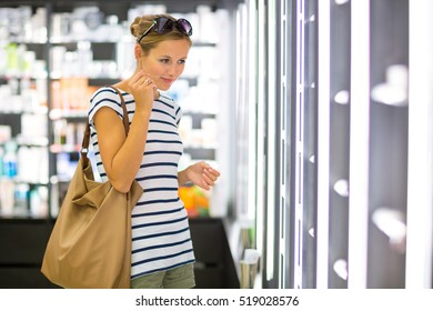 Young woman shopping for the right fragrance/perfume