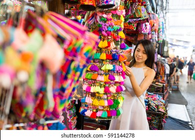 Young woman shopping at street market