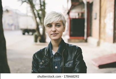 young woman with short blond hair,natural light