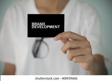 young woman show BRAND DEVELOPMENT , business idea