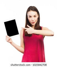 Young woman showing the blank screen of an electronic tablet, isolated on white