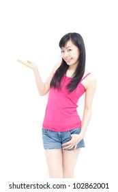 Young woman showing copy space, isolated on white background