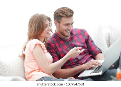 young woman showing her boyfriend's photo on the laptop.