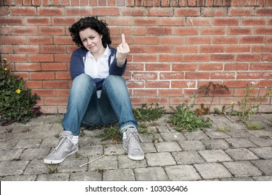 Young woman showing middle finger expressing frustrations and anger