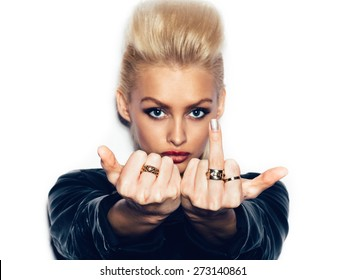 Young woman showing middle finger over white background, not isolated
