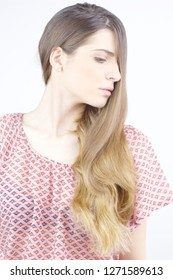 Young woman showing off very long hair isolated