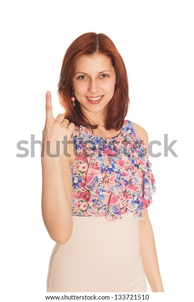 young woman showing one finger on a white background isolated