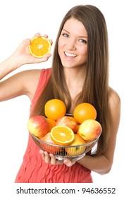 Young woman showing orange fruit at camera