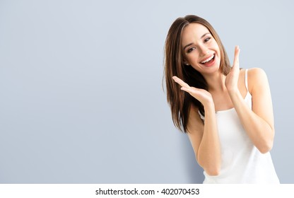 young woman showing smile, in casual smart clothing, with copyspace for slogan or text message