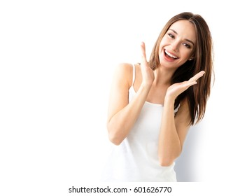 young woman showing smile, in casual smart clothing, isolated against white background