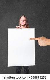 young woman showing a white billboard