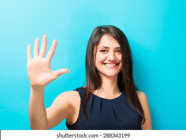 young woman shows a hand stop sign