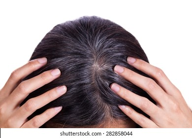 Young woman shows her gray hair roots