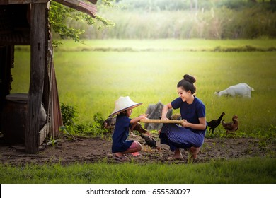 Young woman and sister with agriculture of thailand and use sufficiency economy to live in countryside.