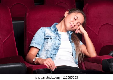 young woman sitting alone in the cinema