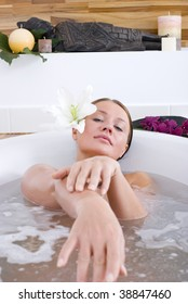 Young woman sitting in a bath