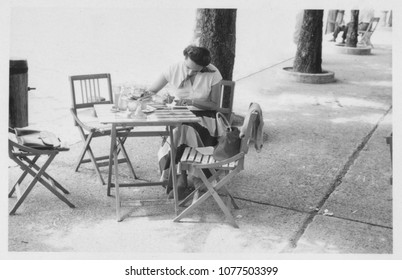 Young woman sitting at cafe in 1950