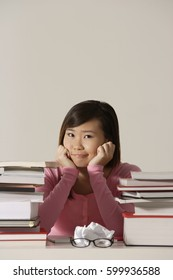 young woman sitting at desk.