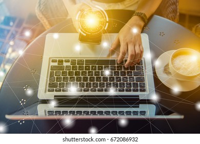 Young woman sitting at desk and typing on laptop to working online at computer in the morning. Concept of networking and occupation, hands close up. Female working on an outdoor cafe.