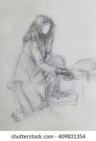 young woman sitting in front of computer drawing , paper background.