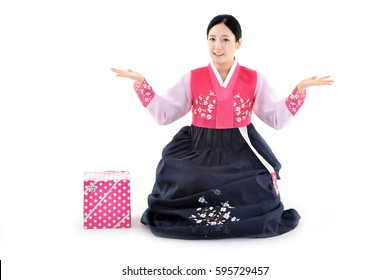 Young woman sitting with gift box in korean traditional dress