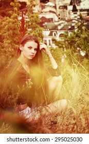 Young woman sitting in the grass