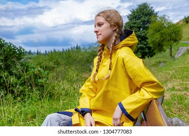 Young woman sitting on a bench in nature