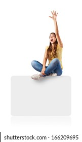 young woman sitting on a box trying to catch something