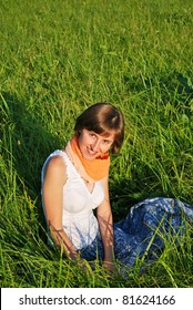 Young woman sitting on the grass