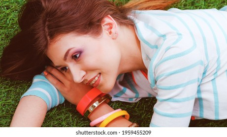 Young woman sitting on green grass . Portreit young woman