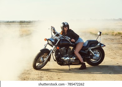 young woman sitting on a motorcycle
